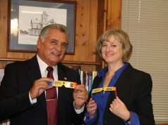 """Ocean County Freeholder Director Joseph H. Vicari and Ocean County Library Director Susan Quinn check out the """"Eclipse Shades"""" that were distributed by the Ocean County Library. (Photo: Ocean County)"""