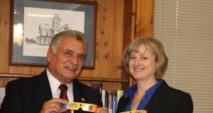 "Ocean County Freeholder Director Joseph H. Vicari and Ocean County Library Director Susan Quinn check out the ""Eclipse Shades"" that were distributed by the Ocean County Library. (Photo: Ocean County)"