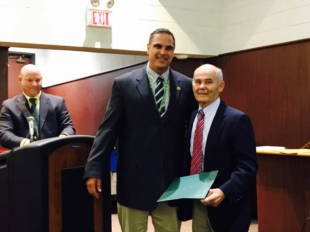 Coach Bob Auriemma (right) with Board President John Lamela and Interim Superintendent Dennis Filippone. (Photo: Daniel Nee)