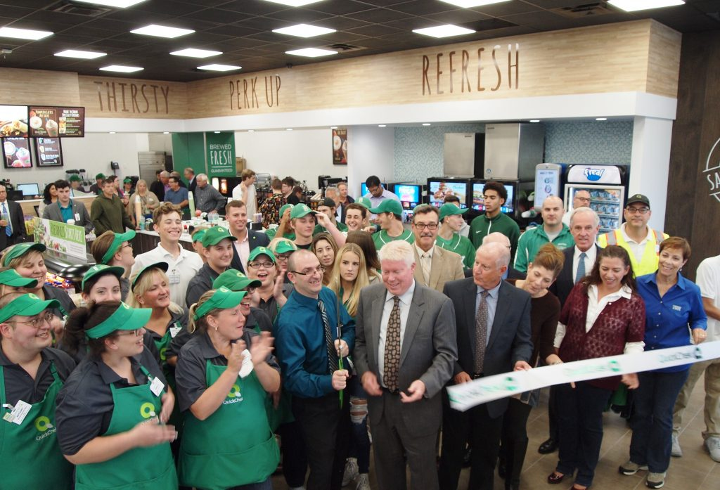 Township officials and store employees at QuickChek cut the ribbon at the new Brick location.