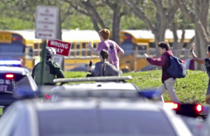 Students and law enforcement outside Marjory Stoneman Douglas High School in Parkland, Fla. (Credit: NBC News)