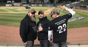 Ma Deuce Deuce President Dennis Addesso, at left, welcomes two fellow veterans to enjoy seats at First Energy Park for a recent Blue Claws minor league baseball game, as part of a night out the nonprofit provides. Photo credit: Ma Deuce Deuce.