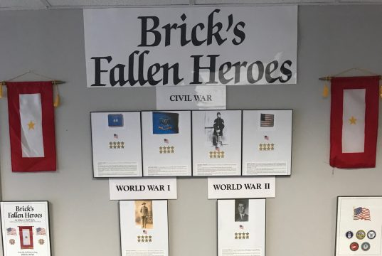 The Fallen Heroes display at the Brick VFW, which will host a special Memorial Day Weekend event sharing the biographies of these soldiers. (Photo by William Duffy)