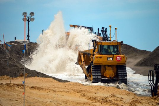 Sand is pumped onto Normandy Beach in Brick, N.J., June 4, 2018. (Photo: Daniel Nee)