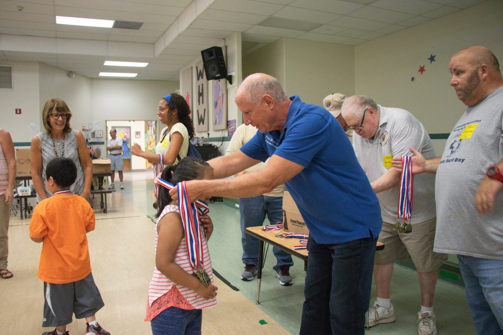 Brick Township council member Paul Mummolo helps award medals after the Knights of Columbus Field Day event, July 2018. (Photo: Chris Chase/Brick Twp.)