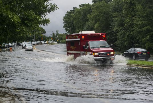 An emergency vehicle makes its way down Burnt Tavern Road in Brick, Aug. 13, 2018. (Photo: Daniel Nee)