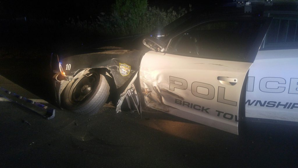 A Brick police car struck with an officer inside. (Photo: Brick Twp. Police)