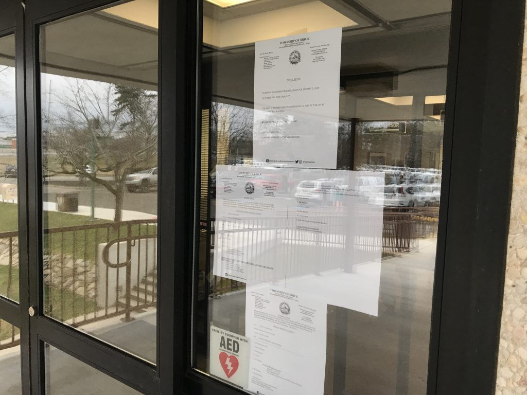 Notices of meeting cancellation taped to the front door of town hall in Brick, Jan. 7, 2019. (Photo: Daniel Nee)