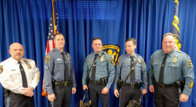 Brick Township Police, from left to right: Chief James Riccio, Sgt. Paul Catalina, K9 Echo, Ptl. Scott Smith, Ptl. John Turrin, K9 Vader, and Captain Steve Gerling.