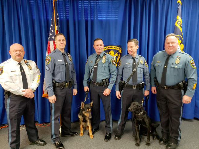 Brick Township Police, from left to right: Chief James Riccio, Sgt. Paul Catalina, K9 Echo, Ptl. Scott Smith, Ptl. John Turrin, K9 Vader, and Captain Steve Gerling.