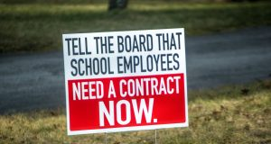 Signs supporting the settlement of a new contract for Brick teachers and staff. (Photo: Daniel Nee)