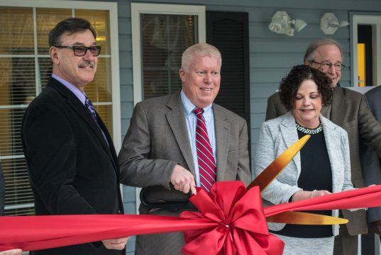Mayor John Ducey (center) and Councilman Jim Fozman help cut to ribbon at a new group home on Drum Point Road. (Photo: Daniel Nee)