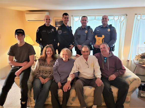 EMT Paul Witham, EMT Supervisor Anthony Botts, Ptl. Mark Storch, and Ptl. Anthony Chadwick (holding an AED). Front row, left to right: Shane Cartwright, Roberta Cartwright, Susan Schwab, Carl Schwab, and Peter Cartwright. Not pictured, EMT Kyle Matthews.