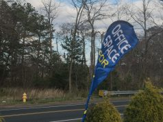 A banner flag advertising office space on Herbertsville Road, April 15, 2019. (Photo: Daniel Nee)