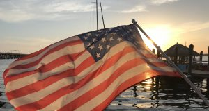 An American flag against a sunset. (Photo: Daniel Nee)