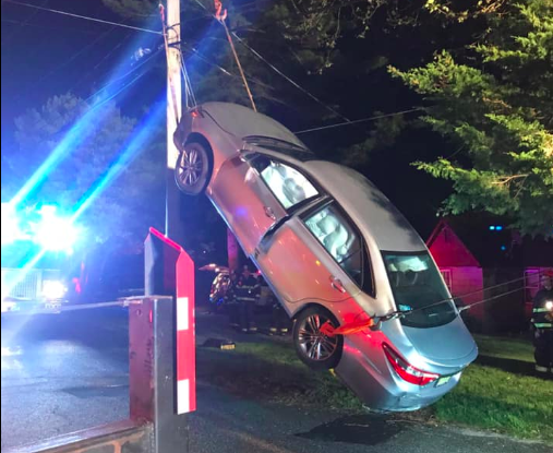 A vehicle propped vertically against a pole, May 12, 2019. (Photo: Laurelton Fire Company)