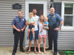 Brick police officers and the Travers family are reunited after their son was saved after choking. (Photo: Brick Twp. Police)