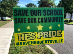 A sign opposing the closure of Herbertsville Elementary School in Brick. (Photo: Daniel Nee)
