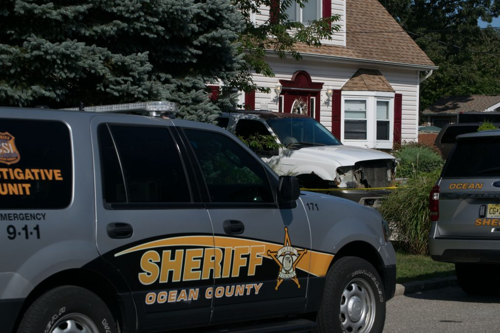 Ocean County Sheriff's Department vehicles outside the site of a suspected homicide in Brick. (Photo: Daniel Nee)