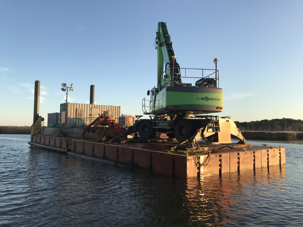 A dredge barge rests in the narrows of the Metedeconk River on Oct. 16, 2019. (Photo: Daniel Nee)