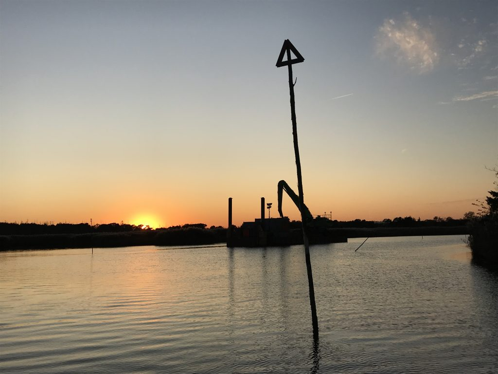 A dredge barge in the distance at sunset, Oct. 16, 2019. (Photo: Daniel Nee)