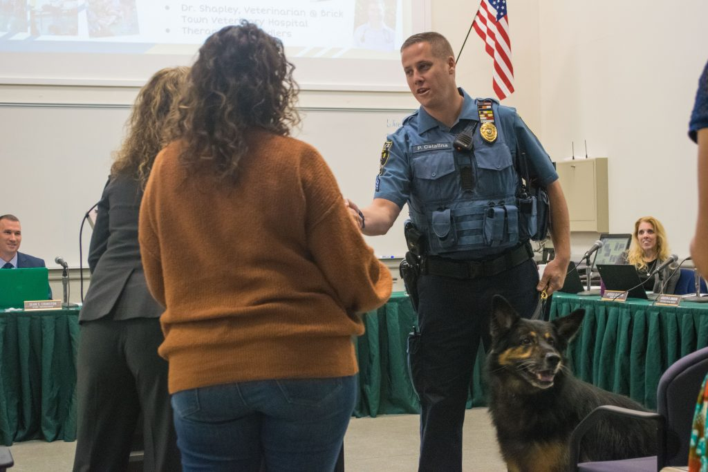 Sgt. Paul Catalina and K9 Duke receive an honor from the Brick Twp. Board of Education, Oct. 2019. (Photo: Daniel Nee)