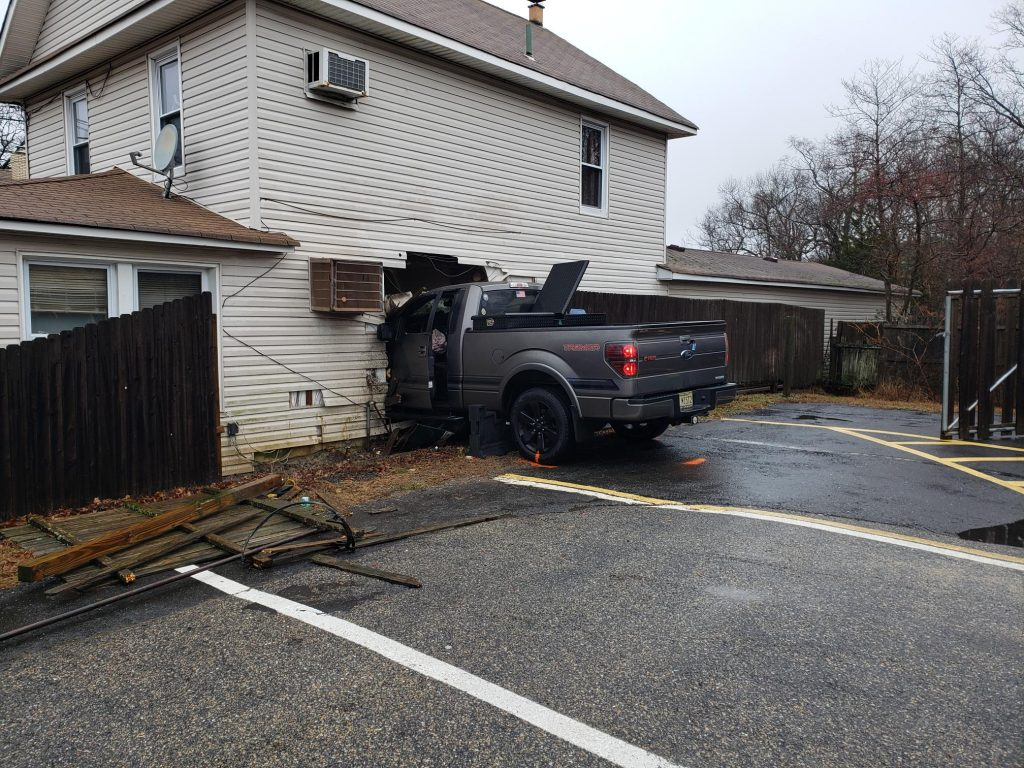 A truck crashes into a home at 372 Drum Point Road. (Photo: Brick Twp. Police)