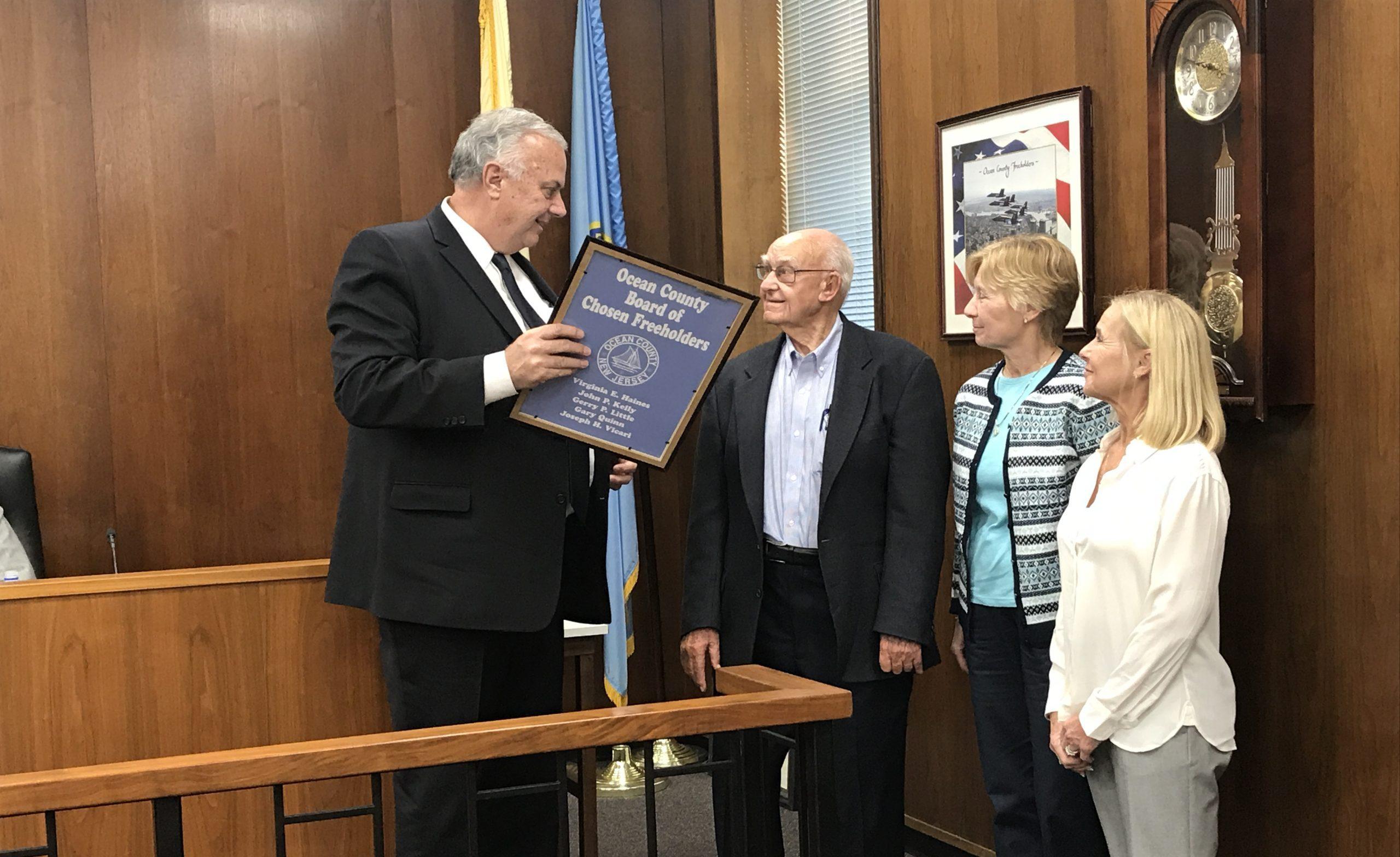 Freeholder Gary Quinn honors retiring OC Planning Board member Donald Bertrand. (Photo: Daniel Nee)