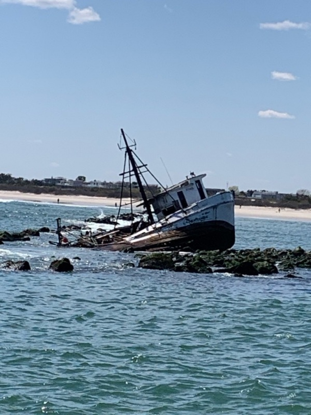 The fishing vessel Bay of Isle sits grounded on the Barnegat Inlet Jetty in Ocean County, N.J., May 7, 2020. The vessel was being monitored after two fishermen ran aground and were rescued by an aircrew from U.S. Coast Guard Air Station Atlantic City, NJ. (U.S. Coast Guard photo by Ensign Holden Bagnal)