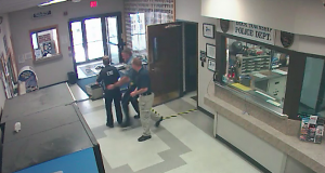 Brick police officers save the life of an EMT at town hall. (Photo: Brick Twp. Police)