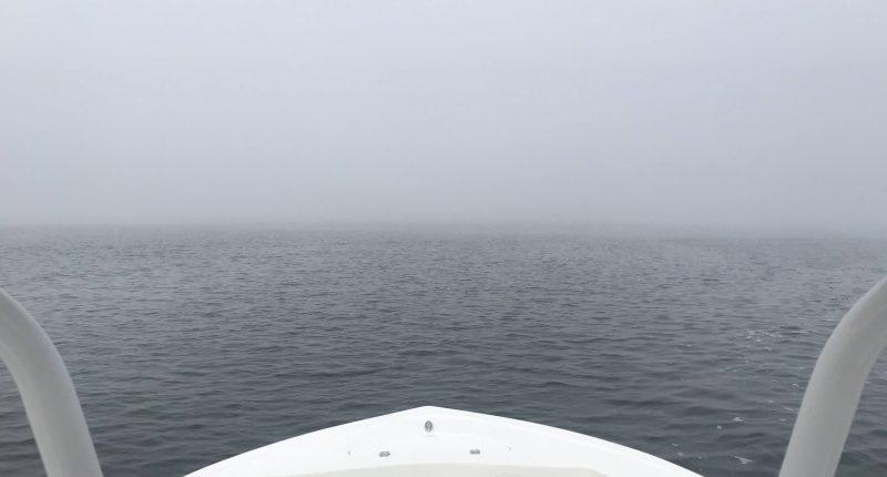 A boat navigates Barnegat Bay in dense fog. (Photo: Daniel Nee)