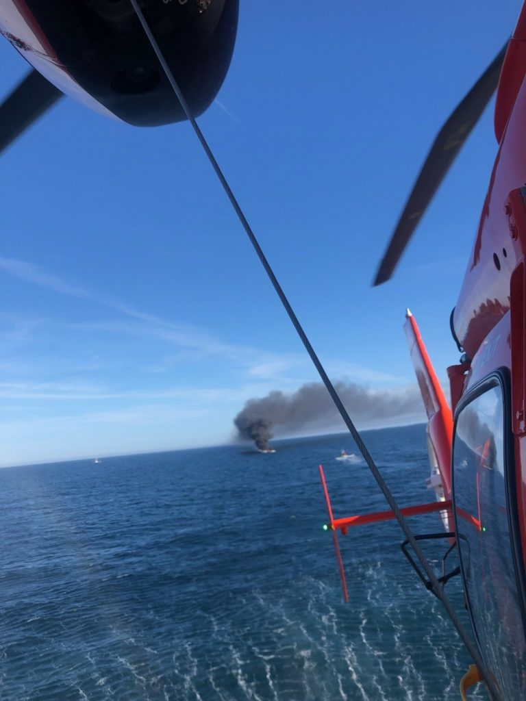 The U.S. Coast Guard rescues anglers from a burning boat off Ocean County, Nov. 5, 2020. (Photo: USCG)