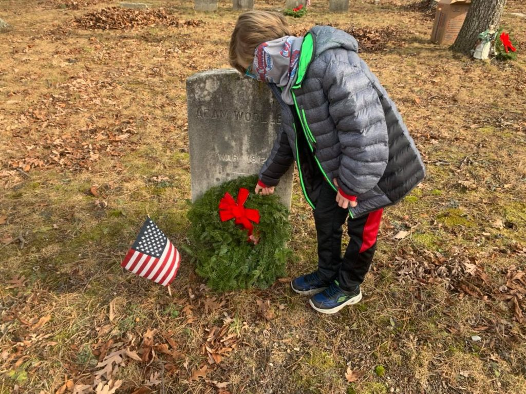 Members of the Brick Township Historical Preservation Commission plant wreaths at the Wooley Cemetery in Brick. (Photo: Brick Township)