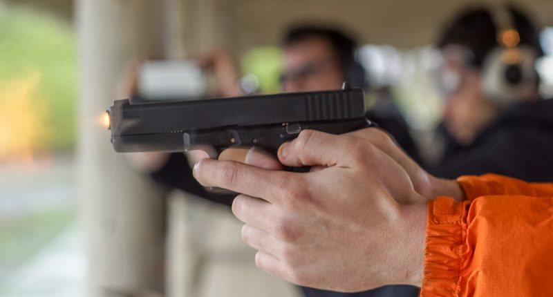 A gun being fired at a range. (Credit: Peretz Partensky/ Flickr)