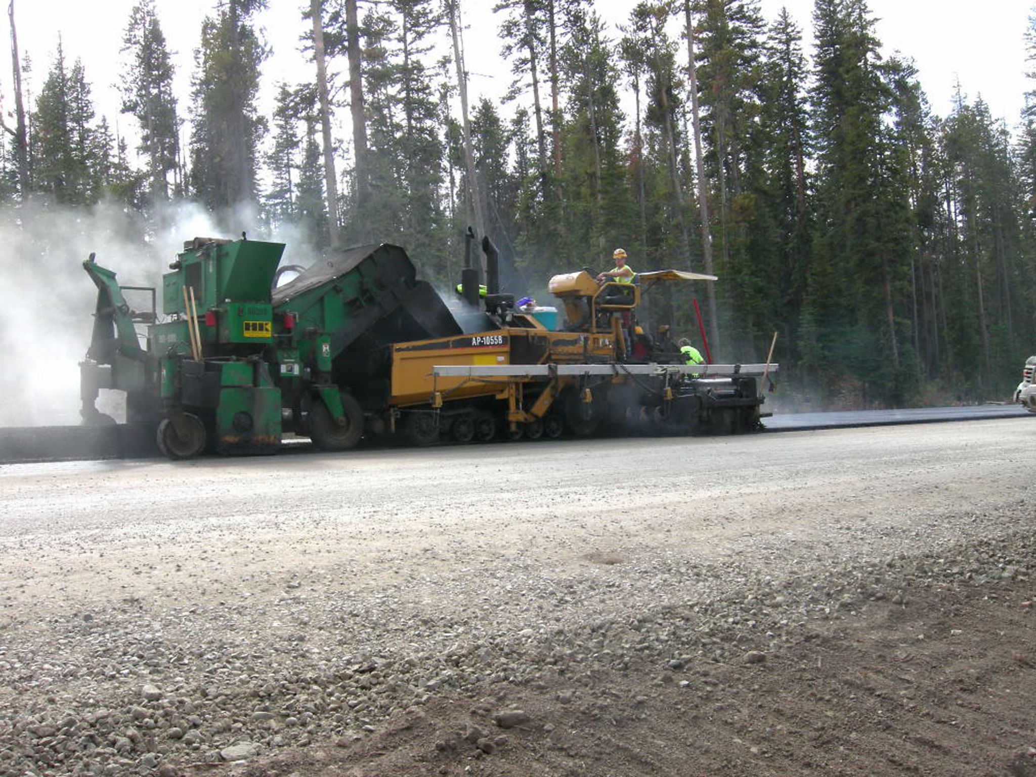 Paving equipment in use. (Credit: Show Us Your Togwotee/ Flickr)