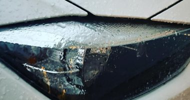 Ice from freezing rain forms on a car's headlight. (Photo: Daniel Nee)