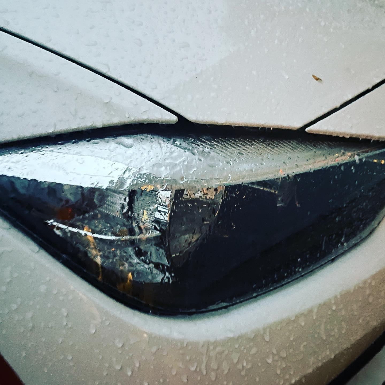 Ice from freezing rain forms on a car's headlight. (Photo: Daniel Nee)