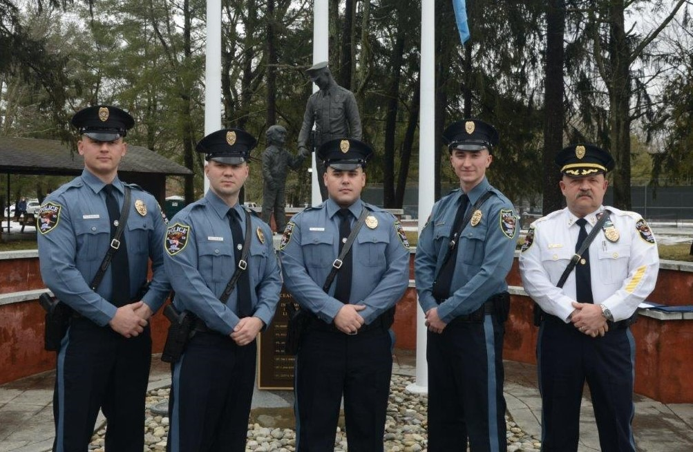 Chief James Riccio with four new Brick police officers. (Photo: Brick Twp. Police)