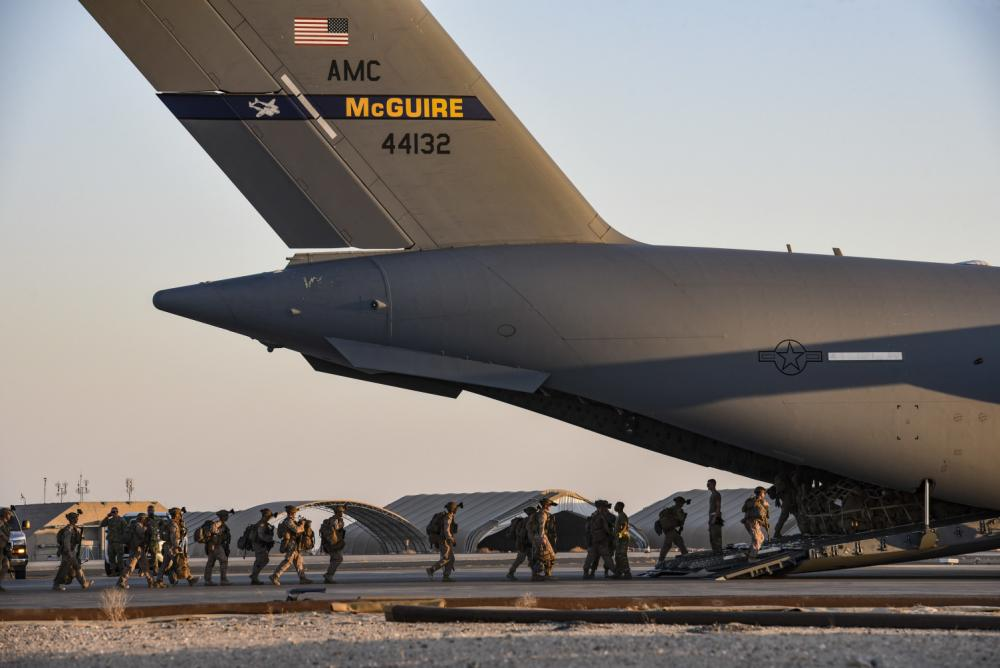 U.S. Marines load onto a U.S. C-17 Globemaster from McGuire Air Force Base to be transported to Afghanistan on August 18, 2021, from Ali Al Salem Air Base, Kuwait. (U.S. Air Force photo by Staff Sgt. Ryan Brooks)