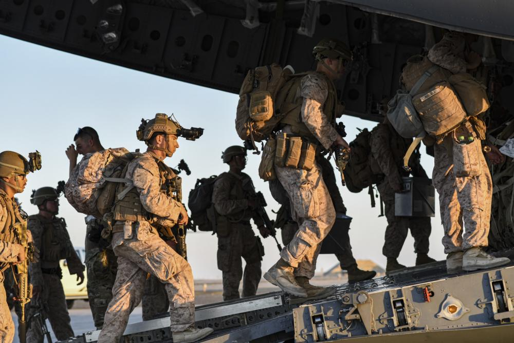 U.S. Marines load onto a U.S. C-17 Globemaster from McGuire Air Force Base to be transported to Afghanistan on August 18, 2021, from Ali Al Salem Air Base, Kuwait. (USAF Photo)